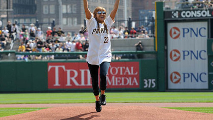 Ali McMutrie of Ben Avon Heights throws out the first pitch at the Pirates season opener against the Dodgers at PNC Park, Monday. McMutrie and her sister Jamie brought a number of orphans from earthquake-ravaged Haiti earlier this year.