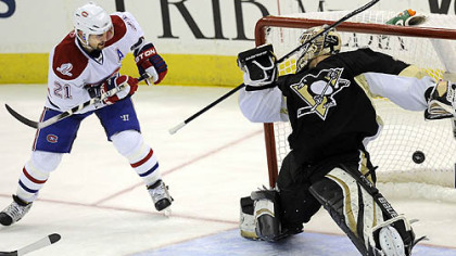 Canadians forward Brian Gionta scores his team's fifth goal beating Penguins goaltender Brent Johnson in the third period of Wednesday's game at Mellon Arena.