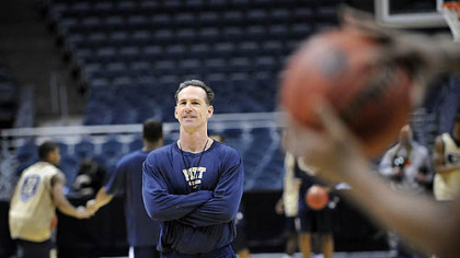 Pitt head coach Jamie Dixon protests as a foul is called on Jermaine Dixon.