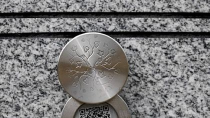 A Memory Medallion on a gravestone.