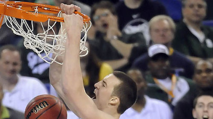 Duke's Miles Plumlee dunks the ball in front of West Virginia's Wellington Smith in the second half of the semifinal game in the NCAA tournament in Indianapolis last night.
