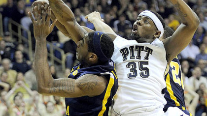 Pitt forward Nasir Robinson gets tangled up with West Virginia forward John Flowers in the first half of Friday&#039;s game at the Petersen Events Center.