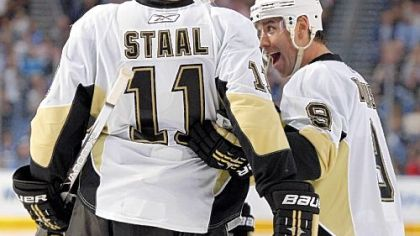 Pascal Dupuis, right, celebrates his third-period goal with Jordan Staal.