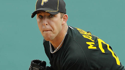 Pirates pitcher Paul Maholm warms up in the first inning.