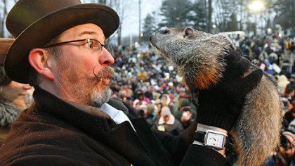 Punxsutawney Phil is held by Ben Hughes after emerging this morning from his burrow on Gobblers Knob in Punxsutawney. Phil saw his shadow and forecast six more weeks of winter weather.