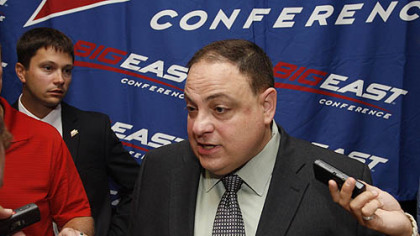 Big East football commissioner John Marinatto speaks with to reporters during the conference&#039;s media day, Tuesday in Newport, R.I.