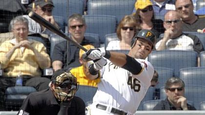 The Pirates' Garrett Jones follows the flight of his two-run home run off Los Angeles Dodgers starting pitcher Vicente Padilla in the first inning of the Opening Day baseball game at PNC Park, Monday.