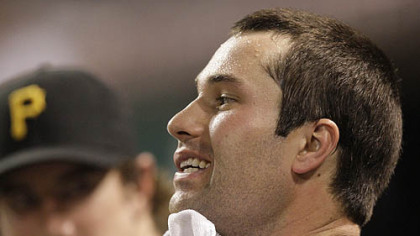 The Pirates' Neil Walker wipes his face in the dugout Tuesday at Great American Ball Park.