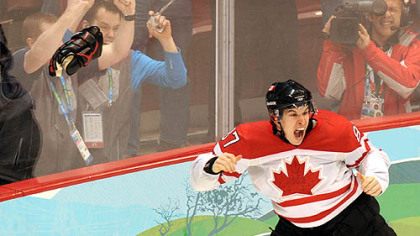 Sidney Crosby  jubilates after scoring the gold medal-winning goal for Canada at the Winter Olympic Games in Vancouver last month. Crosby&#039;s glove, left, and his stick and other glove had gone missing after the game, but were found to be misplaced, not stolen.