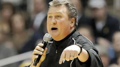 West Virginia head coach Bob Huggins addresses the crowd during the second half of Wednesday's game against Pitt. The game was interrupted twice when fans threw debris on the court.