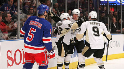 Penguins forawrd Chris Conner celebrates his first period goal at with teammates Sidney Crosby and Pascal Dupuis as Rangers defenseman Dan Girardi skates away.