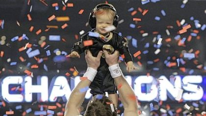 Drew Brees celebrates New Orleans' first Super Bowl win with his son Baylen.