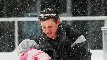 Rachel Grimsley, 6, of Fox Chapel, loses her balance on the ice rink at PPG Place on Monday. Rachel was ice skating with her father, Doug Grimsley.