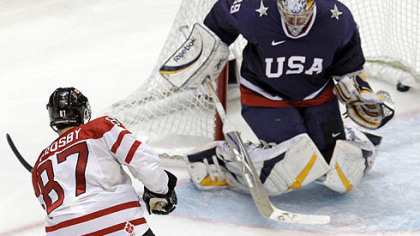 Sidney Crosby finds a hole through the pads of U.S. goaltender Ryan Miller for the overtime goal.