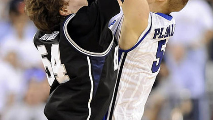 Butler's Matt Howard goes for a rebound against Duke's Mason Plumlee in the first half.
