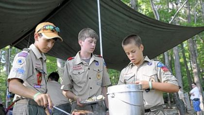 Preparing dinner are, from left, Nick Sisco, 14, Jeremy Hinnebusch, 13, and Eric Stabb, 12, of the Fox Patrol of Troop 329 in McCandless.