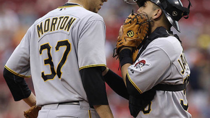 Pirates starting pitcher Charlie Morton talks with catcher Jason Jaramillo in the first inning.
