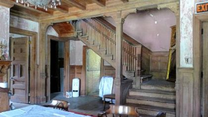 Paneled entrance hall and staircase of the B.F. Jones cottage in Cresson.