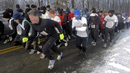 Runners start the Frigid 5-Miler at North Park. Temperatures were at 17 degrees.