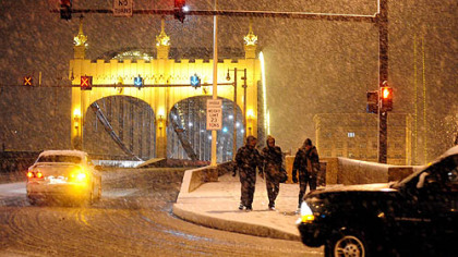 Snow falls on the Smithfield Street Bridge in downtown.