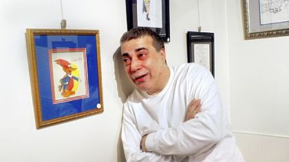 Tony Greco, of Brookline, with Woody Woodpecker at The Gallery on Baum.