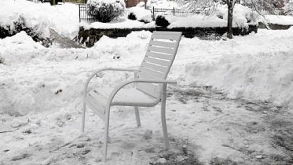 A patio chair saves a shoveled parking space along Pennsylvania Avenue in Manchester.