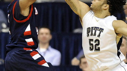 Pitt center Gary McGhee bocks a shot by Robert Morris forward Rob Robinson in the second half of last night&#039;s game at the Petersen Events Center.