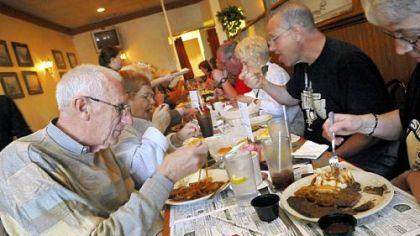 Jim Slopey, left, and his wife, Marcia, of Penn Hills, tuck into the featured dish at their first Liver and Onions Club meeting at Mohan's in Penn Hills.