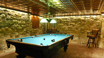 A billiards room inside one of the basement rooms.
