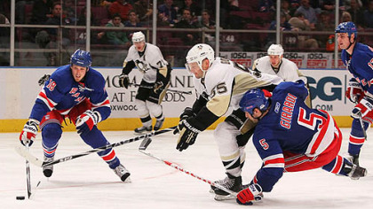 Penguins defenseman Sergei Gonchar battles for the puck against Rangers defensemen Dan Girardi and Marc Staal.