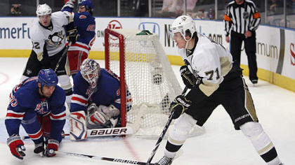 Rangers defenseman Michal Rozsival and goaltender Henrik Lundqvist defend the net against Penguins forward Evgeni Malkin during the third period.