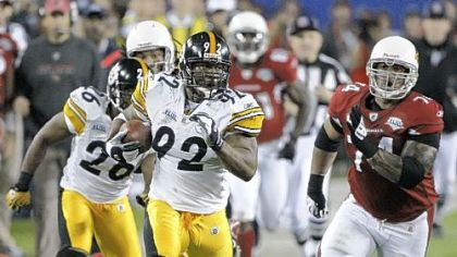 Pittsburgh Steelers linebacker James Harrison returns an interception for a 100-yard touchdown during the second quarter of Super Bowl XLIII, Sunday, Feb. 1, 2009, in Tampa, Fla.