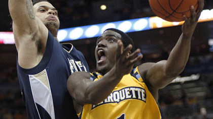 Marquette&#039;s Darius Johnson-Odom drives to the basket against Pitt&#039;s Gary McGhee during the first half.