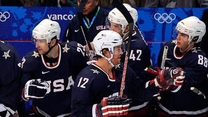 Ryan Malone is congratulated at the U.S. bench after his second-period goal against Switzerland Tuesday.