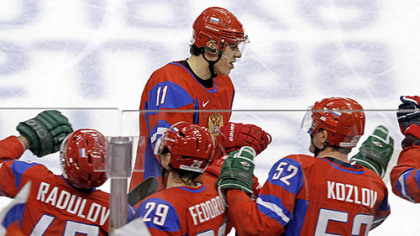 Center Evgeni Malkin is congratulated at the Russian bench after the first of two goals Sunday.