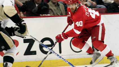 Red Wings forward Henrik Zetterberg rushes the puck up ice during the second period of Detroit's 3-1 home win at Joe Louis Arena, Monday.