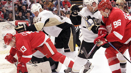 Red Wings forward Pavel Datsyuk, left and Tomas Holmstrom battle with Penguins forward Jordan Staal, left, and defenseman Alex Goligoski during the second period.