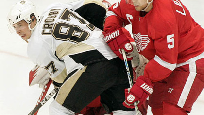 Red Wings captain Nicklas Lidstrom pushes Penguins captain Sidney Crosby away from the goal during the third period of Detroit's 3-1 home win at Joe Louis Arena, Monday.
