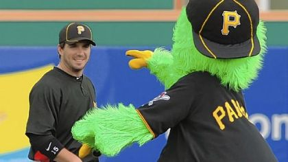 The Pirate Parrot gets the attention of Andy LaRoche before an exhibition game this week at McKechnie Field in Bradenton, Fla.