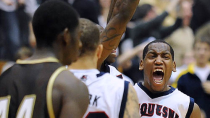 Duquesne's Damian Saunders celebrates the Dukes' 70-69 win vs. St. Bonaventure at the Palumbo Center -- their first A-10 win of the season.
