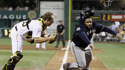 Pirates catcher Erik Kratz tags out the Brewers' Prince Fielder who was attempting to score in the eighth inning on a single to right field by Alcides Escobar.