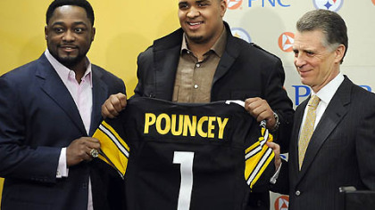 The Steelers&#039; first-round draft pick Maurkice Pouncey poses with head coach Mike Tomlin and president Art Rooney II during a press conference at the team&#039;s South Side facilities, earlier this year.