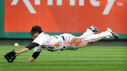 Right fielder Delwyn Young stretches out but can't come up with a single by San Francisco's Bengie Molina Saturday night at PNC Park.