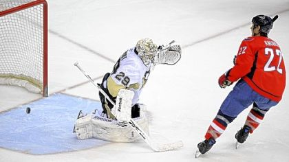 Through this pileup in the Penguins' net, Washington's Mike Knuble scores a goal against Marc-Andre Fleury in the second period Wednesday night in Washington. Jordan Staal tries to stop Knuble, who would later win the game in a shootout.