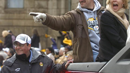 Former Steelers coach Bill Cowher and wife Kaye greet fans during a parade celebrating the team&#039;s victory in Super Bowl XL, Feb. 7, 2006.