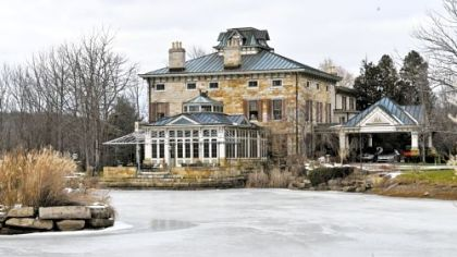 The 11,000 square-foot Riverstone Estate mansion and its south pond.