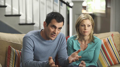 "Phil and Claire Dunphy, played by Ty Burrell and Julie Bowen, appear to be talking to a camera crew in ""Modern Family."""