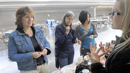 Alice Julier, left, head of Chatham University's new master of arts in food studies program, chats with Amy Soergel of Soergel Orchards at the Farm to Table conference at the David L. Lawrence Convention Center in March.