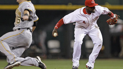 Reds second baseman Brandon Phillips turns to throw the Pirates&#039; Jeff Clement (not shown) out at first base in the seventh inning. The Pirates&#039; Andy LaRoche safely advances to second. Phillips was injured on the play and left the game after the inning.