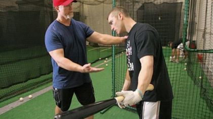 Cardinals hitting coach Mark McGwire, left, works with infielder Brendan Ryan during a training session at a baseball practice facility in Huntington Beach, Calif., Jan. 13.